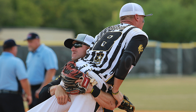 Army Staff Sgt. James Sessom of USAG Hawaii raised in celebration of Army's win during the 2017 Armed Forces Men's and Women's Softball Championship 19-23 September at Joint Base San Antonio-Fort Sam Houston, Texas.