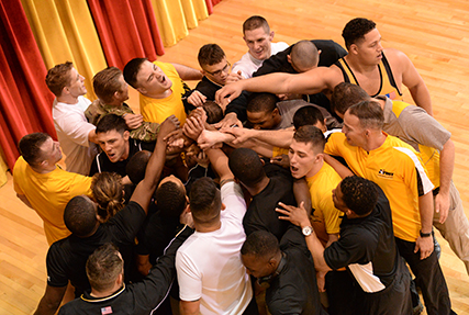 The U.S. Army team celebrates its Armed Forces freestyle title. Photo by Lt. Joe Painter, U.S. Navy