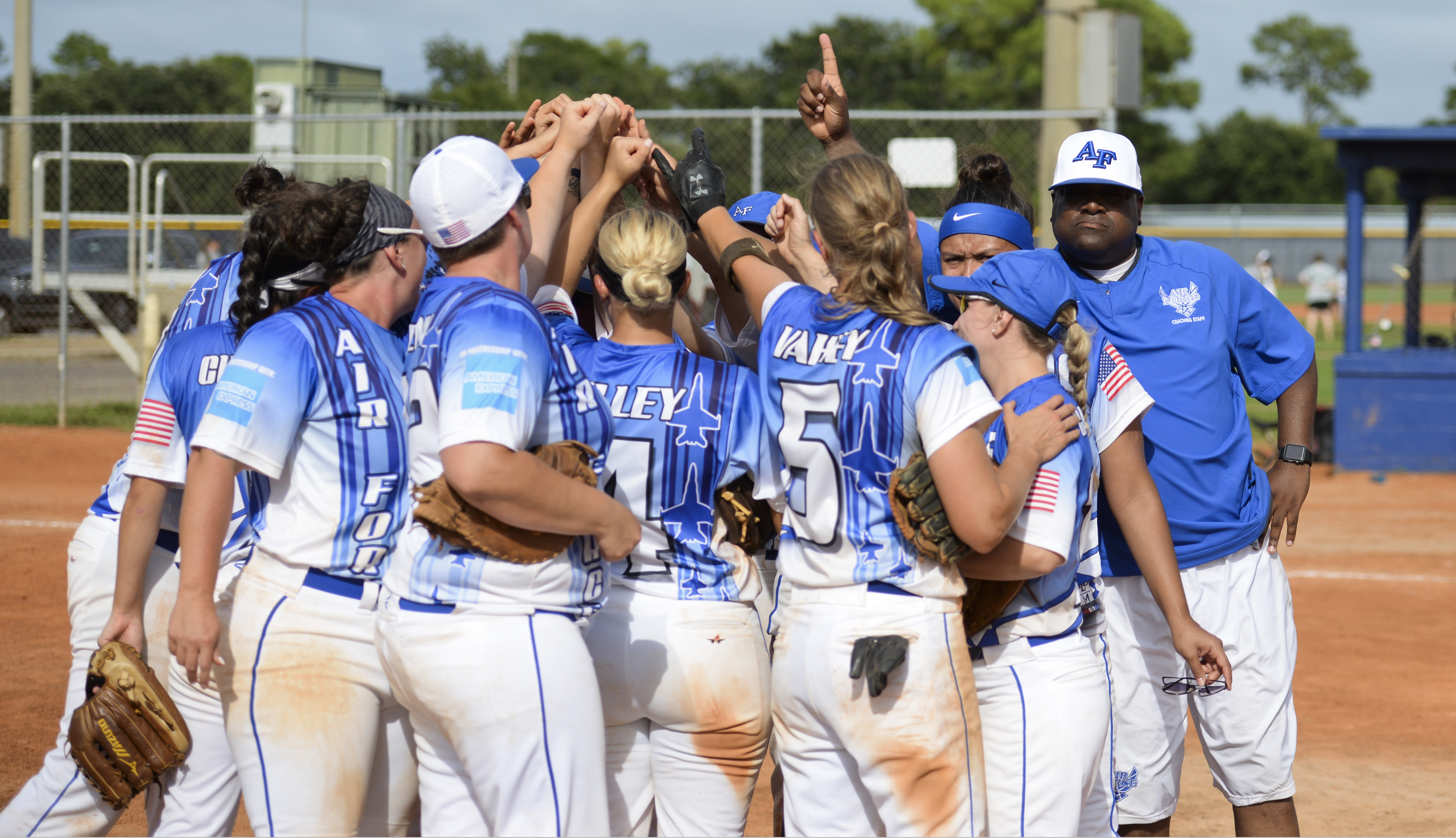 The All Air Force team huddles for a team-high five after winning gold for the second year running during the 2018 Women's Armed Forces Softball Championship, Aug. 15-17. Teams from the Navy, Army and Marine Corps look to dethrone the defending champion Air Force team. (U.S. Navy photo by Mass Communication Specialist 2nd Class Timothy A. Hazel/Released)