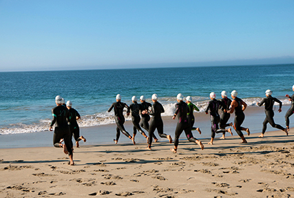 Athletes enter the Pacific Ocean at Point Mugu Beach for the start of the 2021 Armed Forces Triathlon Championship held on 11 September. Service members from the Marine Corps, Navy (with Coast Guard) personnel), and Air Force (with Space Force personnel) compete for gold. (Department of Defense Photo, Released)