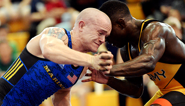 Marine Sgt. Raymond Bunker, from Villa Park, Ill., locks arms with his opponent during a match in the 2018 Armed Forces Wrestling Championship. Bunker is a member of the Armed Forces Sports program's All-Marines wrestling team. AFS All-Service teams provide servicemembers opportunities to participate in national and international competitions including the Military World Games and the Olympics. Servicemembers can advance to the All-Service level sports by competing in unit level intramurals through their branch's sports and fitness program. (U.S. Navy photo by Lt. Joe Painter) (Photo by Lt. Joe