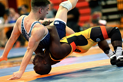 CAMP LEJEUNE, N.C. (Feb. 25, 2018) Army Sgt. Ryan Mango, from St. Louis, Mo., throws Airman 1st Class Dakota Ball, from Monroe, Mich., in the 65 kg weight class of the 2018 Armed Forces Wrestling Championship Freestyle competition. Mango is a member of the Armed Forces Sports program's All-Army wrestling team and Ball is a member of the All-Air Force team. AFS All-Service teams provide servicemembers opportunities to participate in national and international competitions including the Military World Games and the Olympics. Servicemembers can advance to the All-Service level sports by competing in unit level intramurals through their branch's sports and fitness program. (U.S. Navy photo by Lt. Joe Painter)
