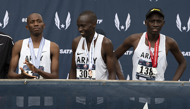 From left, Army Sgt. Hillary Bor, Army Sgt. Leonard Korir, and Army Sgt. Emmanuel Bor stand on an awards stage with their medals after placing the 2nd, 3rd, and 4th in the USA Track and Field Cross Country Championship in Tallahassee, Fl. Feb. 2, 2019. The sergeants finished 1st, 2nd, and 3rd in the 2019 Armed Forces Cross Country Championship which ran simultaneously with the USATF event. DoD photo by EJ Hersom